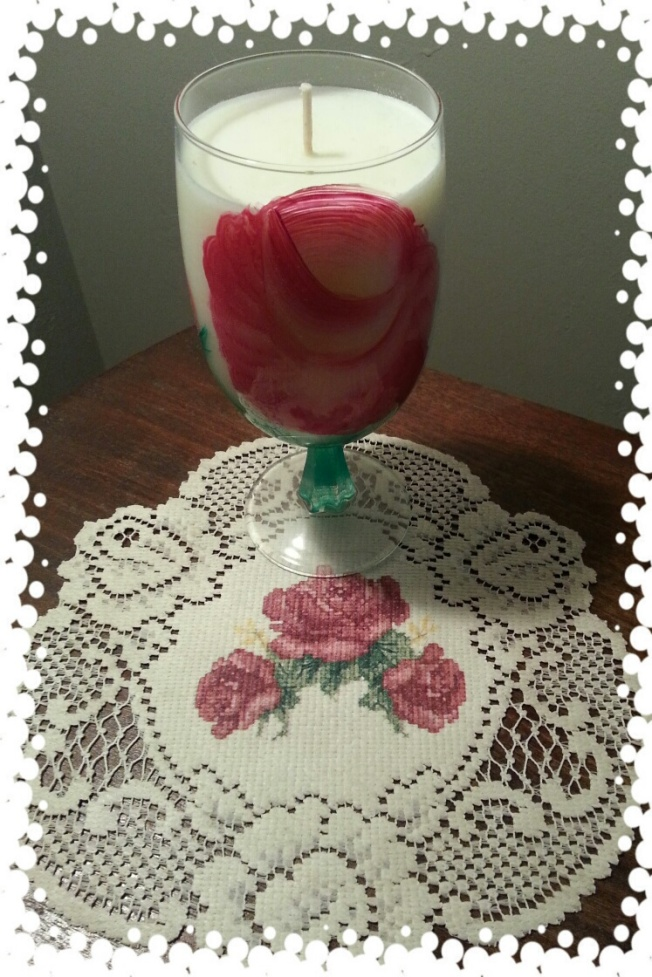 two of my favorites...red roses...rose scented homemade candle by my friend at prairie lights (she has a blog)